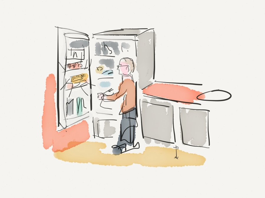 man standing at fridge door, looking for butter
